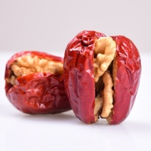 Walnut halves tasty snack nuts with red date