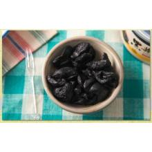 a Healthy Food with peeled Black Garlic