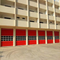 High speed vertical sectional door