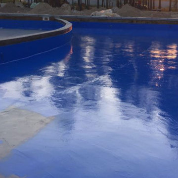 Concrete sealer around swimming pool deck