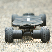 Carving deck electric skateboard with direct drive motor