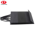 Black branded logo paper bag with ribbon