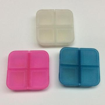 Plastic mini portable four-grid pill case