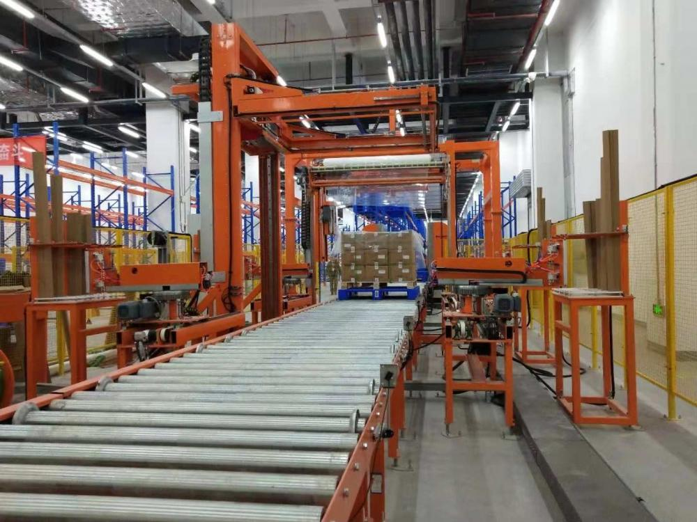 Auto pallet wrapping strapping corner application system