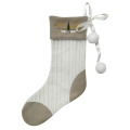 Christmas knitted stocking with cute plush ball