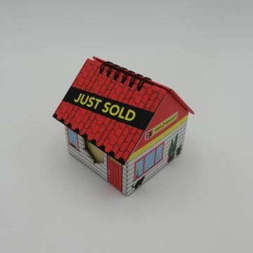 house-shaped sticky note with clendar