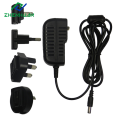 Adaptador intercambiável do poder do plugue do curso de 12V1.5A 18W