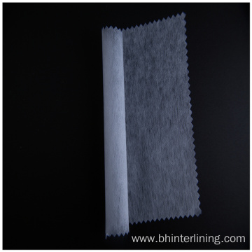 Shrink resistant double dot non woven fusible interlining