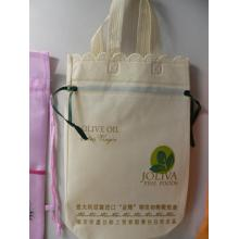 Small size pull-styled non woven oil bag