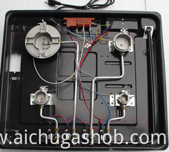 inside of four burner gas hob with AC ignition