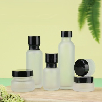 Cosmetic Frosted glass bottle with black caps