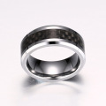 Tungsten carbide ring with carbon fiber inlay