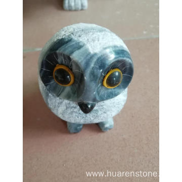 Grey granite owl carving
