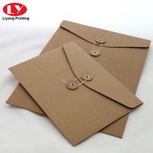 Brown kraft envelope with string and button