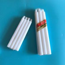 West Africa market white wax candle stock