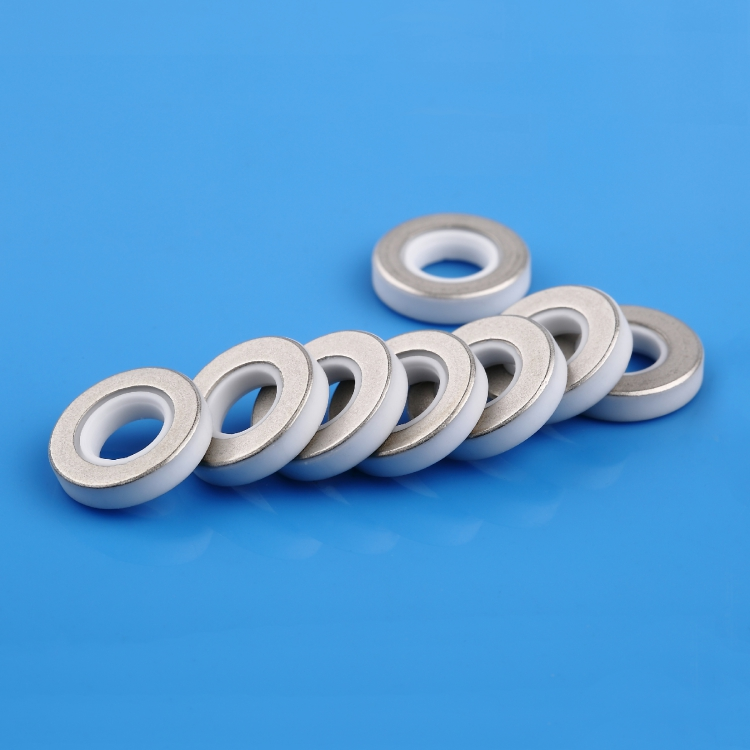 Metallized ceramic spacer