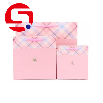 Xmas pink cellophane paper bags with handles