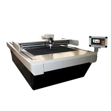 Digital cutter with pressing roller
