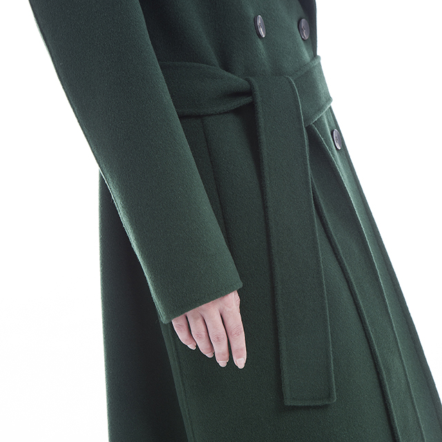 The lower half of a green cashmere overcoat