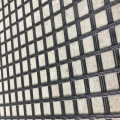 Composite fiberglass geogrid with geotextile