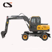 mini excavator with grapple used in forest