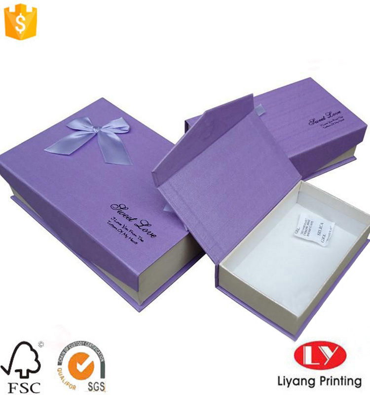 Book shaped cardboard gift box with ribbon