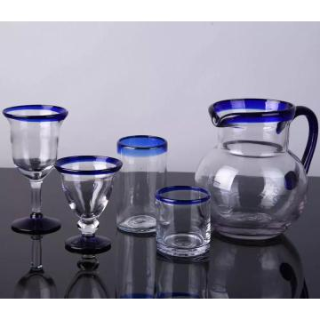 blue color edge drinking glass goblet cup and pitcher