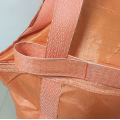 White bulk bag with orange belt