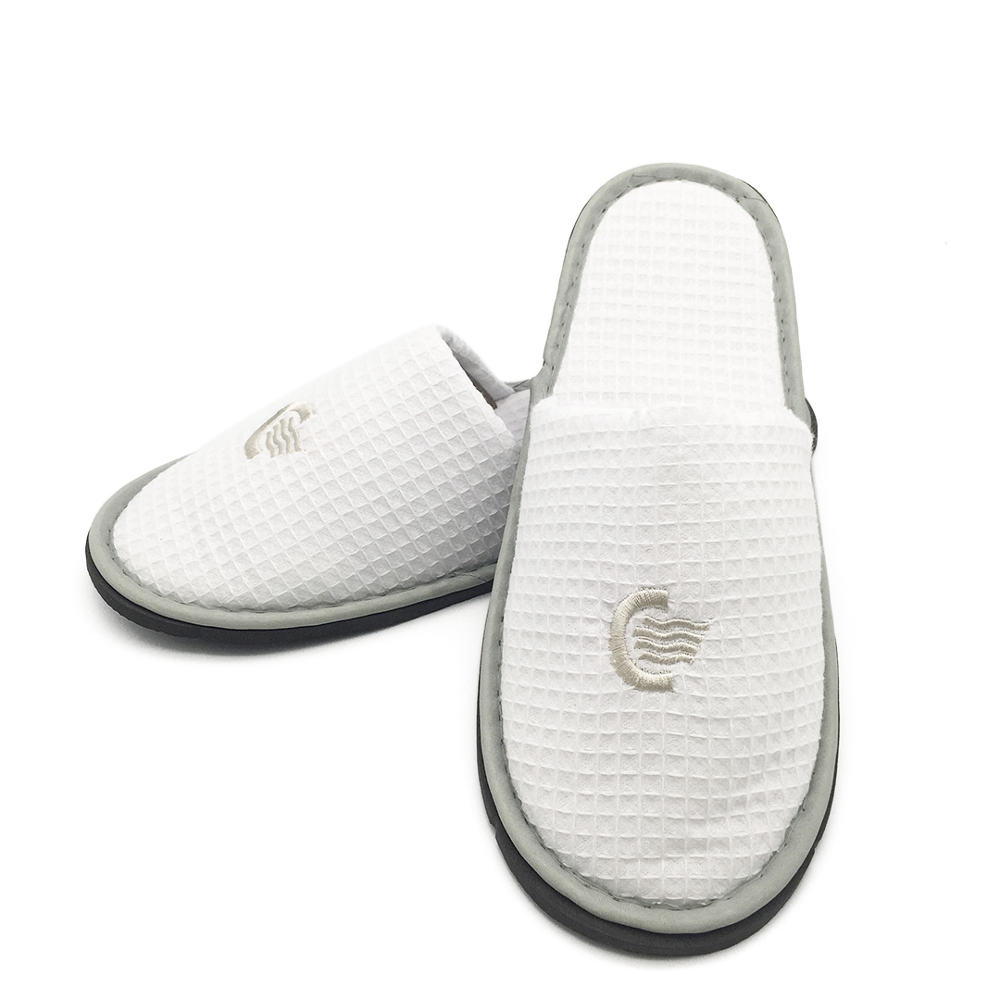 White fluffy personalized hotel slippers