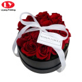 Black round flower box with ribbon handle