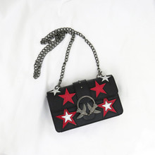 Star decorative leather shoulder bag