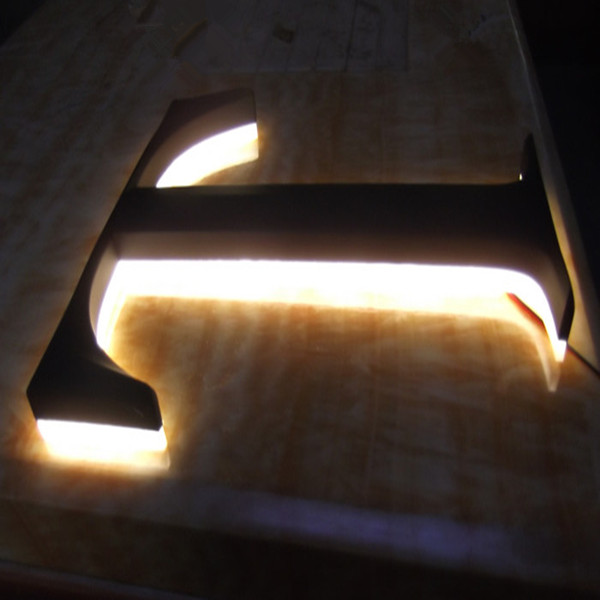 painted prismatic back lit letters
