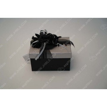 A modest ribbon flower gift box