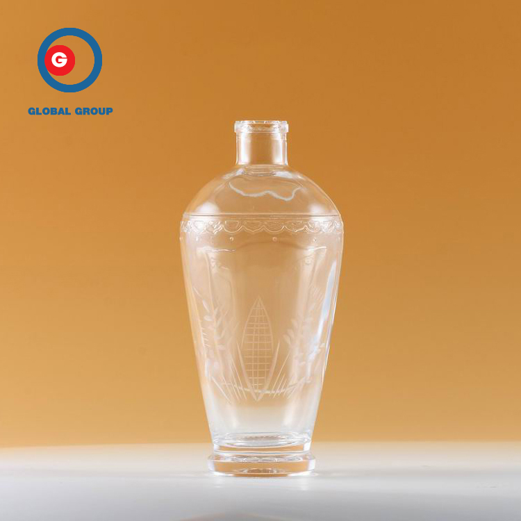 Hot Sale Round Shape Unique Carved Glass Transparent Bottle Glass Bottle 700ml