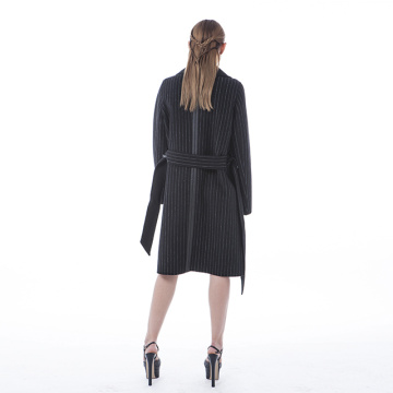 Mature black striped cashmere coat