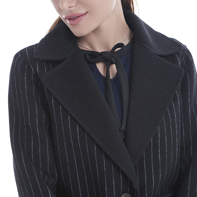 The collar of a black striped cashmere overcoat