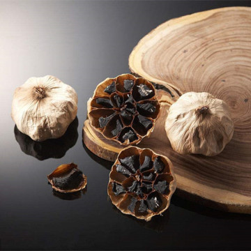 Uncracked whole black garlic with skin in jar