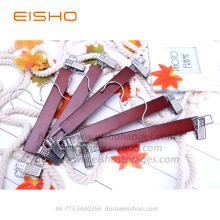 China Gold Supplier for Wood Hangers For Clothes EISHO Wooden Skirts Pants Hanger With Clips supply to United States Factories