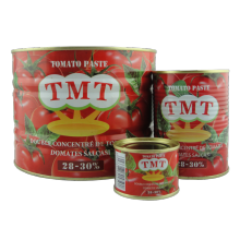 tin tomato paste with yellow ceramic inside
