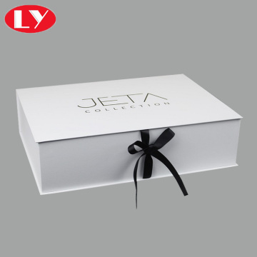 White gift packaging box with black ribbon