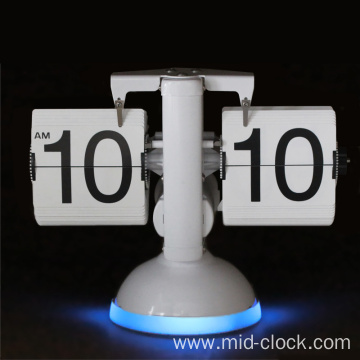 Desk clock with sounds controlled light