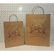 Leading for Brown Kraft Paper Bag With Twist Handle Kraft Paper Printing Logo Handbag supply to China Hong Kong Supplier