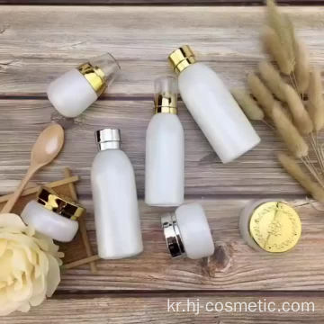 Wholesale High-grade golden carved ABS cap white glass cosmetic bottles/jars with good price