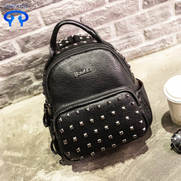 The rivet shoulder backpack style PU leather