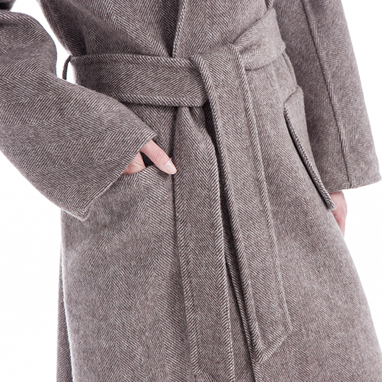 The upper end of a cashmere jacket with a belt for women in winter