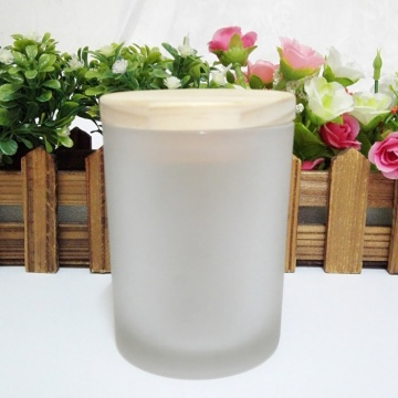 scented soy wax candle in frosted glass jar
