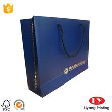 Blue paper gift bag with silver foil logo