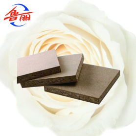 Particle board for decorative surface