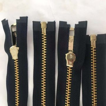 Continuous unique golden metal zippers for coat
