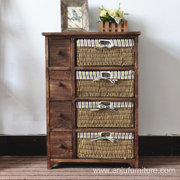 4 tier Tall wood cabinet with many drawers with rattan basket